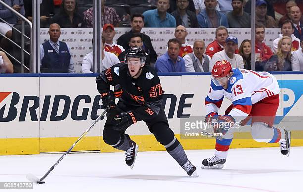 Connor McDavid of Team North America charges up ice with Pavel Datsyuk of Team Russia chasing during the World Cup of Hockey 2016 at Air Canada...