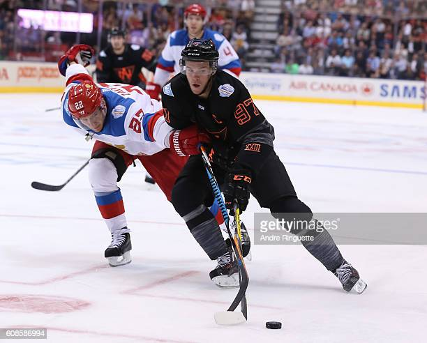 Connor McDavid of Team North America stickhandles the puck away from Nikita Zaitsev of Team Russia during the World Cup of Hockey 2016 at Air Canada...