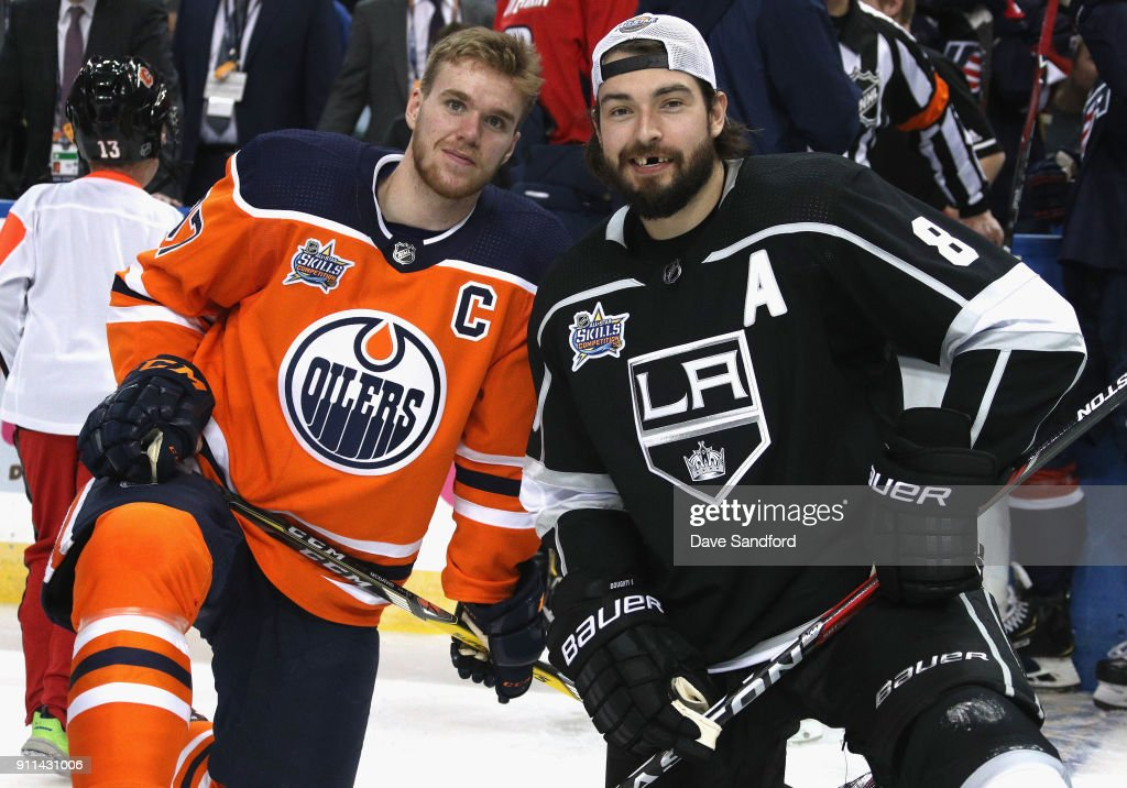 Connor McDavid #97 of the Edmonton Oilers (L) and Drew Doughty #8 of the Los Angeles Kings (R) pose together during the 2018 GEICO NHL All-Star Skills Competition at Amalie Arena on January 27, 2018 in Tampa, Florida.