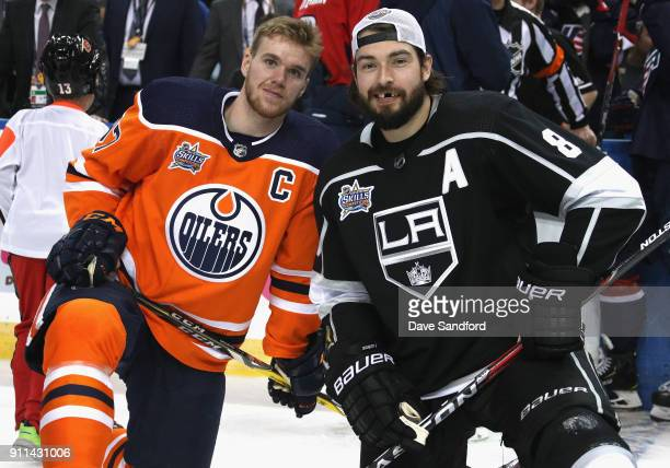 Connor McDavid of the Edmonton Oilers and Drew Doughty of the Los Angeles Kings pose together during the 2018 GEICO NHL AllStar Skills Competition at...