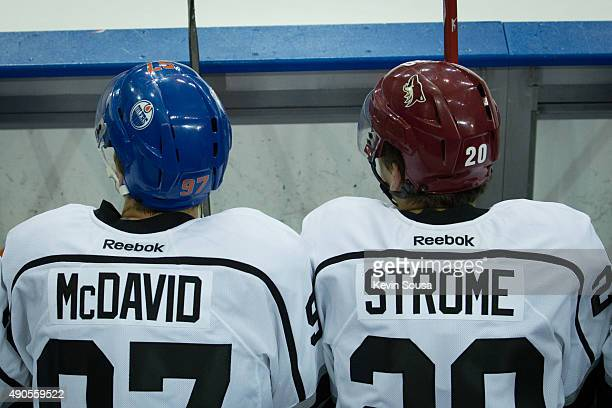 Connor McDavid of the Edmonton Oilers and Dylan Strome of the Arizona Coyotes await their next shift during a scrimmage at the 2015 NHLPA Rookie...