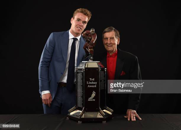 Connor McDavid of the Edmonton Oilers and Ted Lindsay pose for a portrait with the Ted Lindsay Award at the 2017 NHL Awards at TMobile Arena on June...