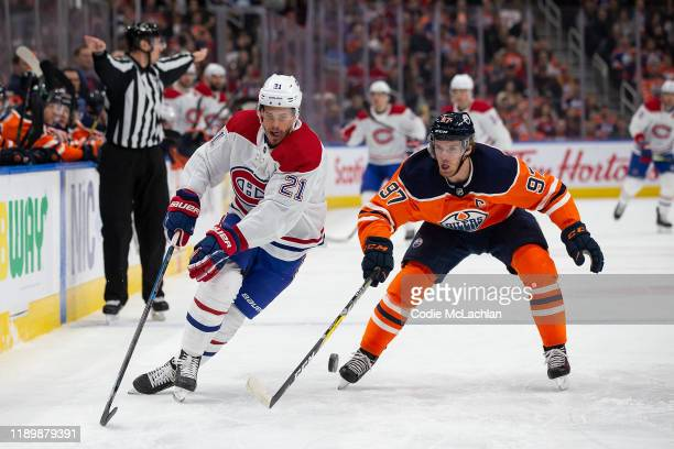 Connor McDavid of the Edmonton Oilers battles against Nick Cousins of the Montreal Canadiens at Rogers Place on December 21 in Edmonton Canada