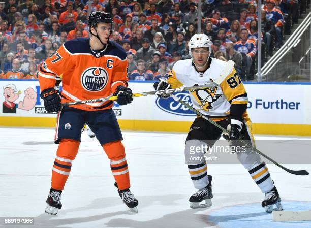Connor McDavid of the Edmonton Oilers battles for position against Sidney Crosby of the Pittsburgh Penguins on November 1 2017 at Rogers Place in...