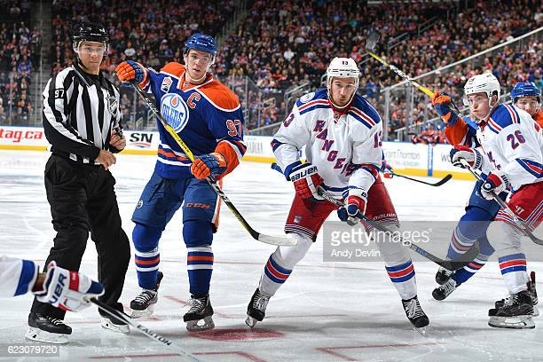 Connor McDavid of the Edmonton Oilers battles for the puck against Kevin Hayes of the New York Rangers on November 13 2016 at Rogers Place in...