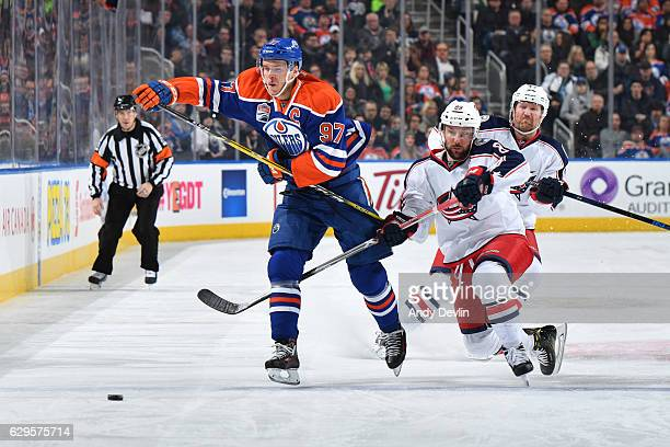 Connor McDavid of the Edmonton Oilers battles for the puck against Sam Gagner the Columbus Blue Jackets on December 13 2016 at Rogers Place in...