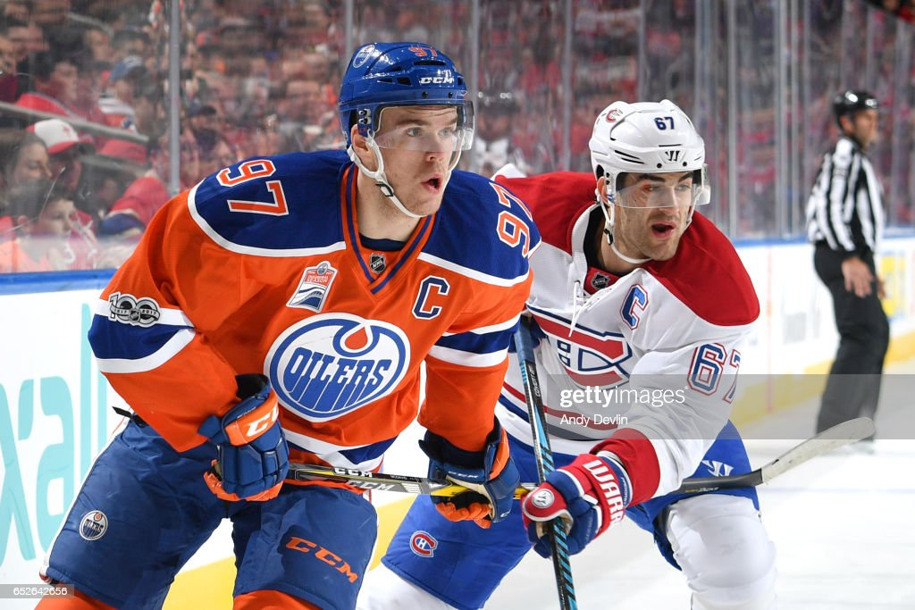 Connor McDavid #97 of the Edmonton Oilers battles for the puck against Max Pacioretty #67 of the Montreal Canadiens on March 12, 2017 at Rogers Place in Edmonton, Alberta, Canada.