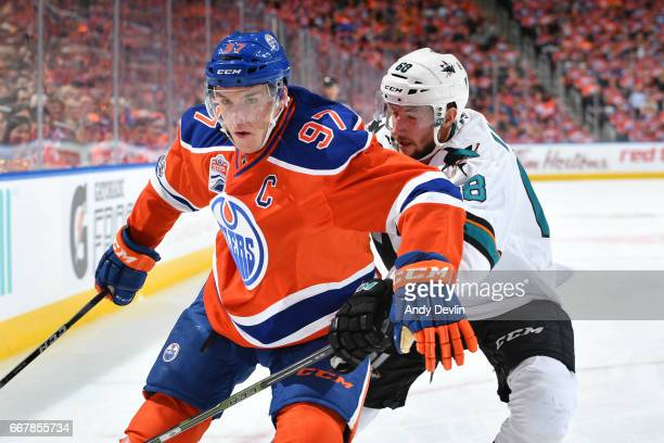 Connor McDavid of the Edmonton Oilers battles for the puck against Melker Karlsson of the San Jose Sharks during Game One of the Western Conference...