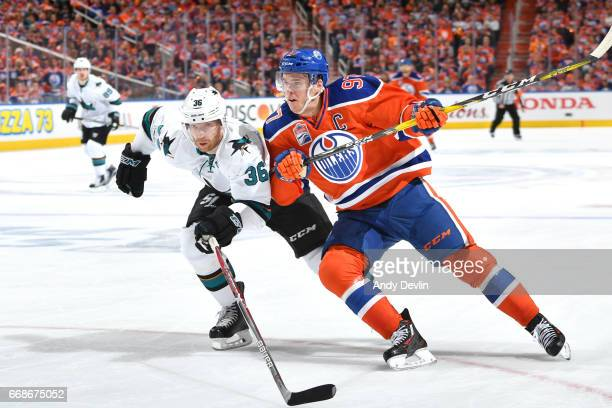 Connor McDavid of the Edmonton Oilers battles for the puck with Jannik Hansen of the San Jose Sharks in Game Two of the Western Conference First...