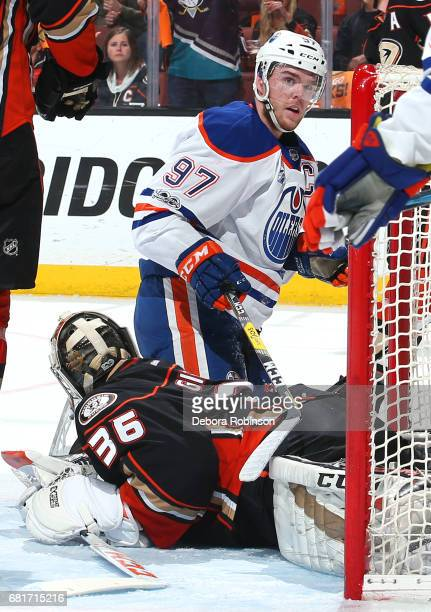Connor McDavid of the Edmonton Oilers battles in the crease against John Gibson of the Anaheim Ducks in Game Seven of the Western Conference Second...