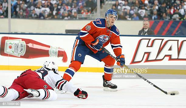 Connor McDavid of the Edmonton Oilers beats Toby Enstrom Winnipeg Jets to feed Darnell Nurse for a goal against the Jets during the 2016 Tim Hortons...