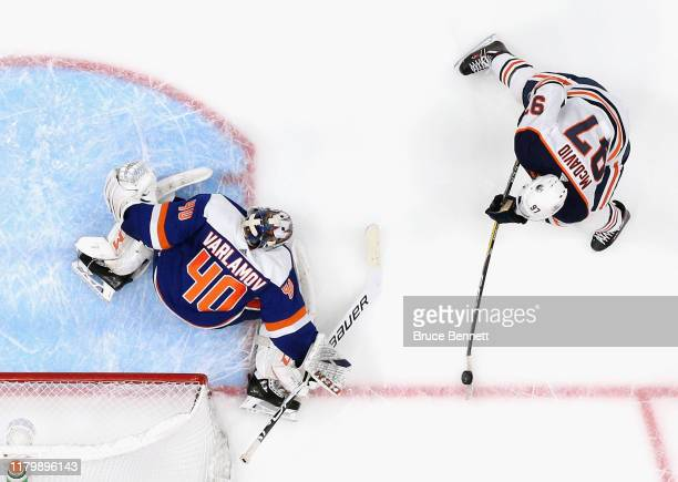 Connor McDavid of the Edmonton Oilers carries the puck against Semyon Varlamov of the New York Islanders at NYCB's LIVE Nassau Coliseum on October...