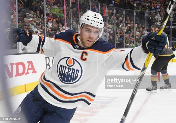 Connor McDavid of the Edmonton Oilers celebrates after he assisted teammate Ryan NugentHopkins on a firstperiod powerplay goal against the Vegas...