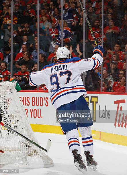 Connor McDavid of the Edmonton Oilers celebrates after his goal against the Calgary Flames at Scotiabank Saddledome on October 17 2015 in Calgary...
