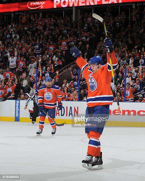 Connor McDavid of the Edmonton Oilers celebrates after scoring a goal during the game against the Vancouver Canucks on April 6 2016 at Rexall Place...