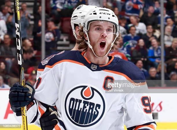 Connor McDavid of the Edmonton Oilers celebrates after scoring during their NHL game against the Vancouver Canucks at Rogers Arena January 16 2019 in...