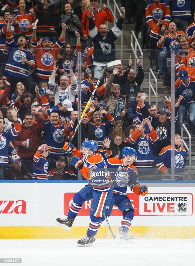 Connor McDavid #97 of the Edmonton Oilers celebrates his 100th point of the season on an assist against the Vancouver Canucks on April 9, 2017 at Rogers Place in Edmonton, Alberta, Canada. The Oilers won 5-2.