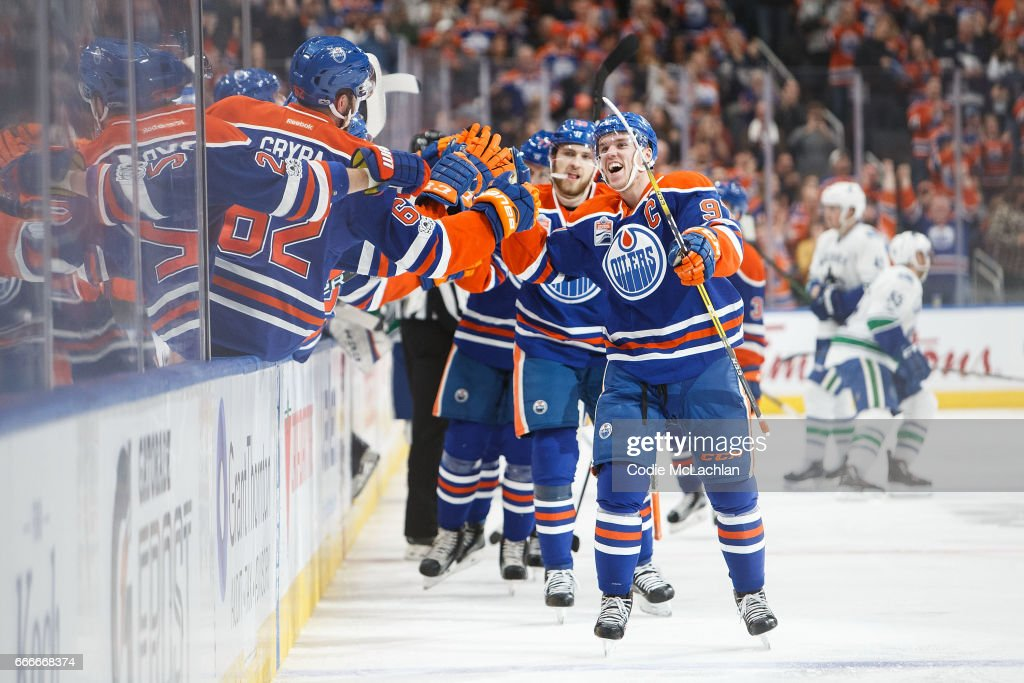 Connor McDavid #97 of the Edmonton Oilers celebrates his 100th point on an assist against the Vancouver Canucks on April 9, 2017 at Rogers Place in Edmonton, Alberta, Canada. The Oilers won 5-2.