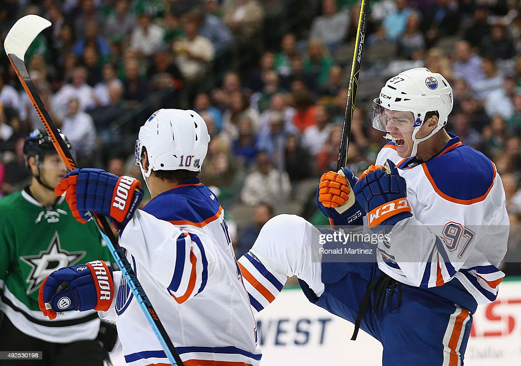 Connor McDavid #97 of the Edmonton Oilers celebrates his first career NHL goal against the Dallas Stars in the second period at American Airlines Center on October 13, 2015 in Dallas, Texas.