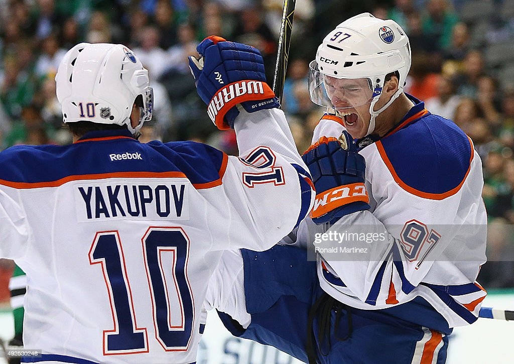Connor McDavid #97 of the Edmonton Oilers celebrates his first career NHL goal with Nail Yakupov #10 against the Dallas Stars in the second period at American Airlines Center on October 13, 2015 in Dallas, Texas.
