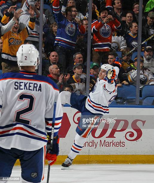 Connor McDavid of the Edmonton Oilers celebrates his game winning overtime goal against the Buffalo Sabres during an NHL game on March 1 2016 at the...