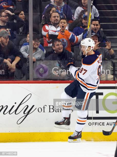 Connor McDavid of the Edmonton Oilers celebrates his game winning overtime goal against Thomas Greiss of the New York Islanders at the Barclays...