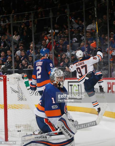 Connor McDavid of the Edmonton Oilers celebrates his gamewinning goal in overtime against Thomas Greiss of the New York Islanders at Barclays Center...