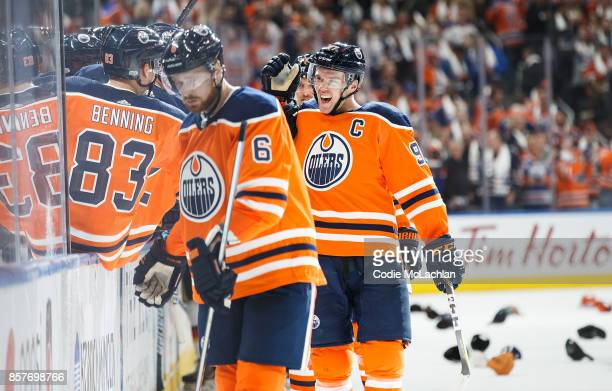 Connor McDavid of the Edmonton Oilers celebrates his hat trick goal against the Calgary Flames at Rogers Place on October 4 2017 in Edmonton Canada