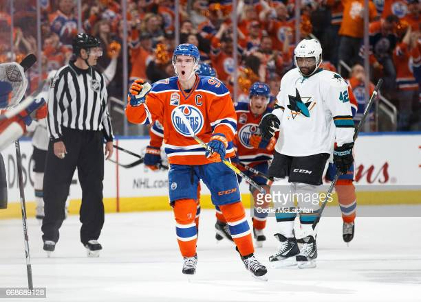 Connor McDavid of the Edmonton Oilers celebrates his short handed goal as Joel Ward of the San Jose Sharks reacts in Game Two of the Western...
