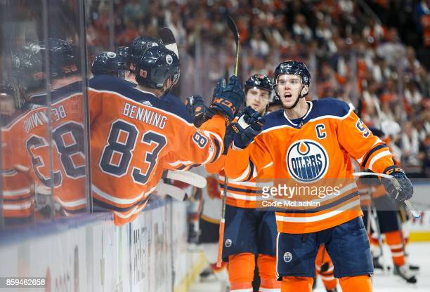 Connor McDavid of the Edmonton Oilers celebrates the first of his three goals on the night against the Calgary Flames at Rogers Place on October 4...