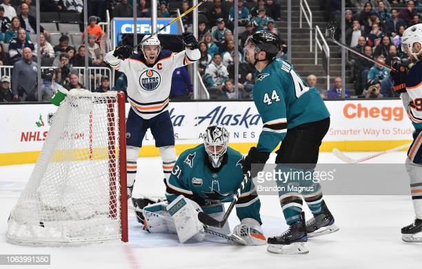 Connor McDavid of the Edmonton Oilers celebrates the gamewinning goal in front of Martin Jones and MarcEdouard Vlasic of the San Jose Sharks at SAP...