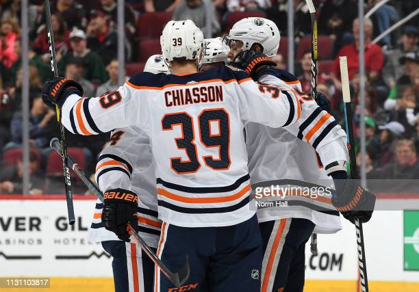 Connor McDavid of the Edmonton Oilers celebrates with Alex Chiasson and teammates after scoring a goal against the Arizona Coyotes during the first...