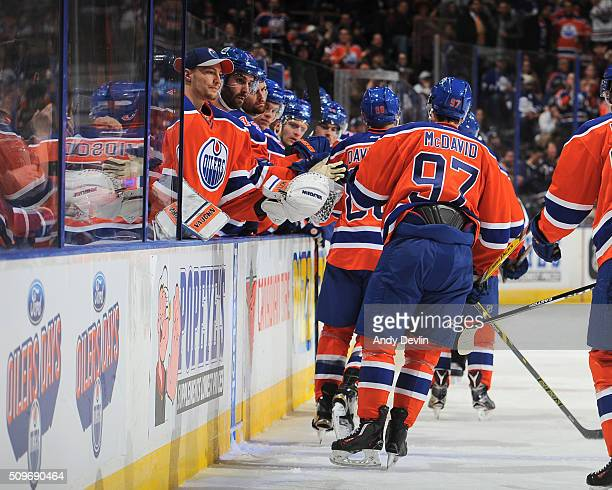 Connor McDavid of the Edmonton Oilers celebrates with teammates after a goal during the game against the Toronto Maple Leafs on February 11 2016 at...