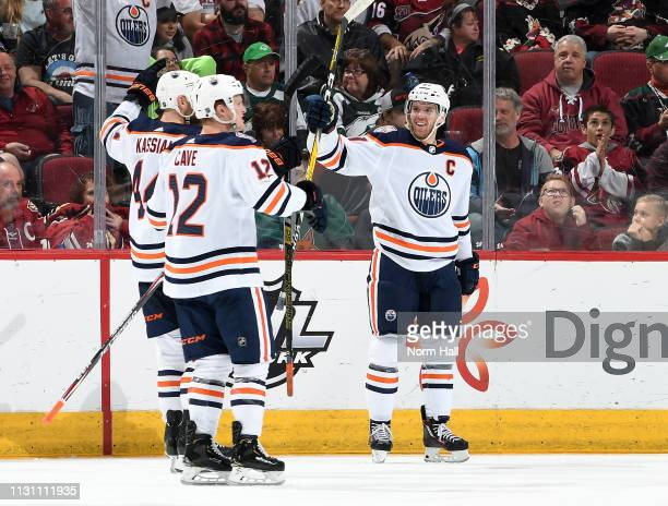 Connor McDavid of the Edmonton Oilers celebrates with teammates Zack Kassian and Colby Cave after scoring the game winning goal in overtime against...
