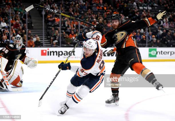 Connor McDavid of the Edmonton Oilers chases after the puck after knocking Matt Irwin of the Anaheim Ducks off balance during the second period at...