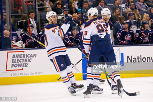 Connor McDavid of the Edmonton Oilers congratulates Jesse Puljujarvi of the Edmonton Oilers after scoring a goal during the third period of the game...