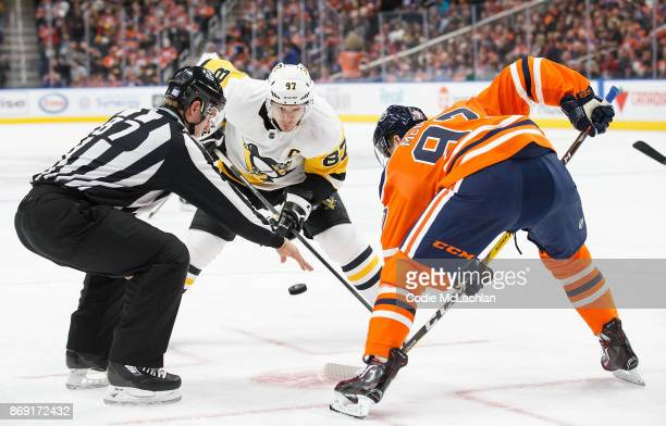 Connor McDavid of the Edmonton Oilers faces off against Sidney Crosby of the Pittsburgh Penguins at Rogers Place on November 1 2017 in Edmonton Canada