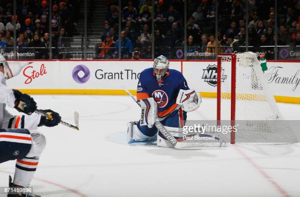 Connor McDavid of the Edmonton Oilers fires the gamewinning goal past Thomas Greiss of the New York Islanders in overtime at Barclays Center on...