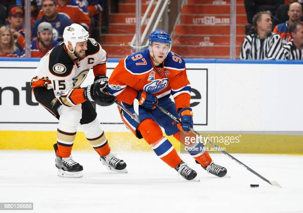 Connor McDavid of the Edmonton Oilers is pursued by Ryan Getzlaf of the Anaheim Ducks in Game Six of the Western Conference Second Round during the...