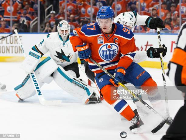 Connor McDavid of the Edmonton Oilers is watched by goalie Martin Jones of the San Jose Sharks in Game One of the Western Conference First Round...