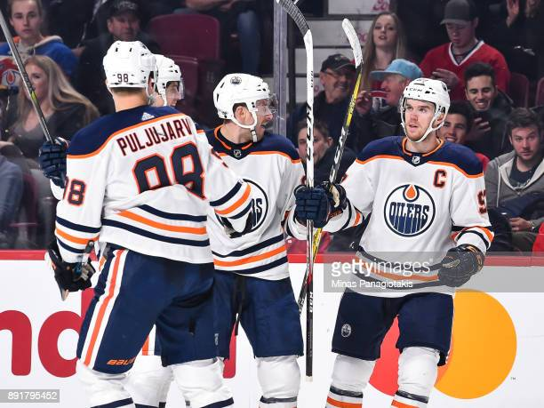 Connor McDavid of the Edmonton Oilers joins his teammates to celebrate a goal by Yohann Auvitu in the third period against the Montreal Canadiens...
