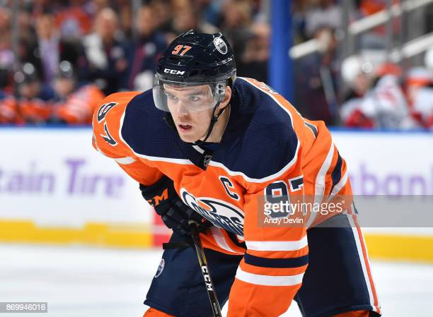 Connor McDavid of the Edmonton Oilers lines up for a face off during the game against the New Jersey Devils on November 3 2017 at Rogers Place in...