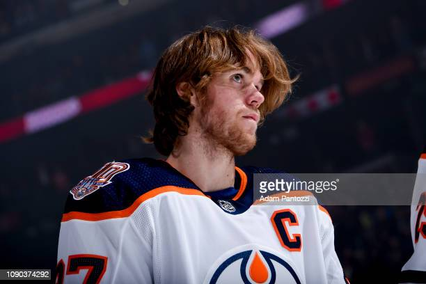 Connor McDavid of the Edmonton Oilers listens to the national anthem before the game against the Los Angeles Kings at STAPLES Center on January 5...