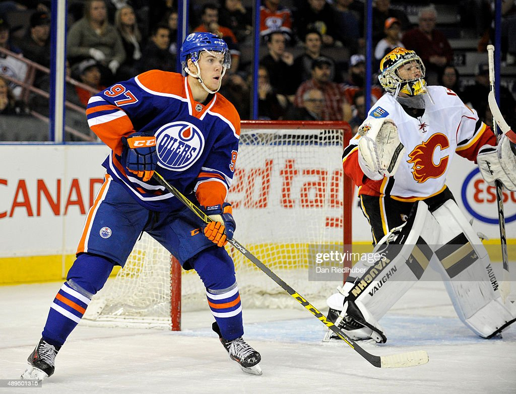 Connor McDavid #97 of the Edmonton Oilers looks for a pass in front of goalie Mason McDonald of the Calgary Flames at Rexall Place on September 21, 2015 in Edmonton, Alberta, Canada.