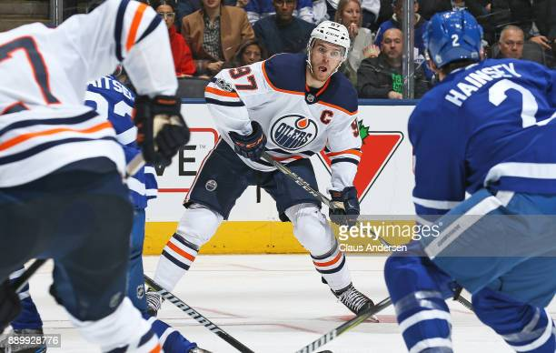Connor McDavid of the Edmonton Oilers looks to make a pass against the Toronto Maple Leafs during an NHL game at the Air Canada Centre on December 10...