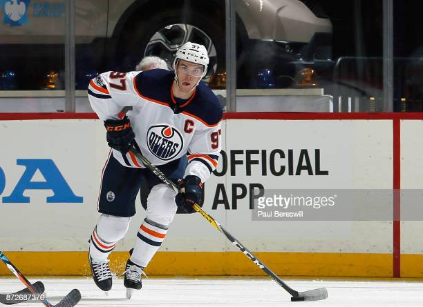 Connor McDavid of the Edmonton Oilers looks to pass in an NHL hockey game against the New York Islanders at Barclays Center on November 7 2017 in the...
