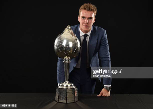Connor McDavid of the Edmonton Oilers poses for a portrait with the Hart Memorial Trophy at the 2017 NHL Awards at TMobile Arena on June 21 2017 in...