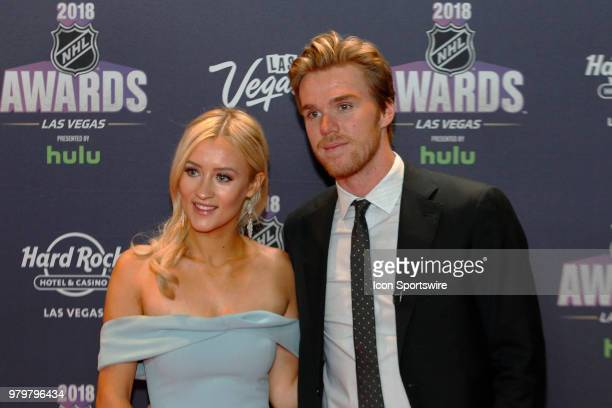 Connor McDavid of the Edmonton Oilers poses for photos on the red carpet with his girlfriend Lauren Kyle during the 2018 NHL Awards presented by Hulu...