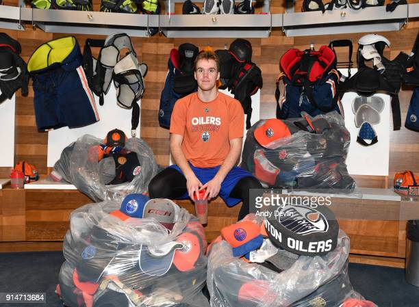 Connor McDavid of the Edmonton Oilers poses with hats collected after his hat trick following the game against the Tampa Bay Lightning on February 5...