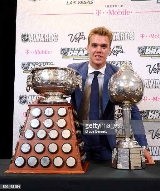 Connor McDavid of the Edmonton Oilers poses with the Art Ross Trophy Hart Memorial Trophy and the Ted Lindsay Award after the 2017 NHL Awards and...
